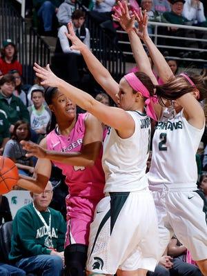 Michigan State's Tori Jankoska, center, and Cara Miller, right, pressure Rutgers' Briyona Canty Sunday, Feb. 22, 2015, in East Lansing, Mich. Michigan State won 60-50.