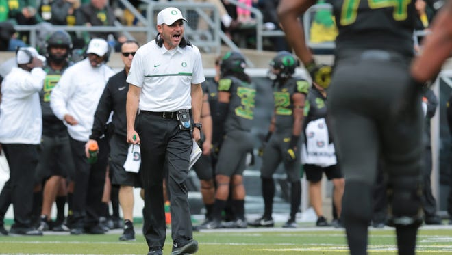 Nov 12, 2016; Eugene, OR, USA; Oregon Ducks head coach Mark Helfrich walks on to the field to speak with officials in the third quarter against the Stanford Cardinal at Autzen Stadium. Mandatory Credit: Scott Olmos-USA TODAY Sports