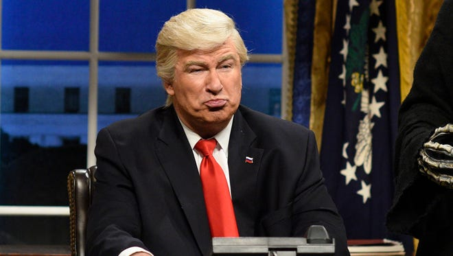 "This Feb. 4, 2017, file photo released by NBC shows Alec Baldwin portraying President Donald Trump in the opening sketch of ""Saturday Night Live,"" in New York. Baldwin returned to ""SNL"" as President Trump for the first time in a month Saturday."