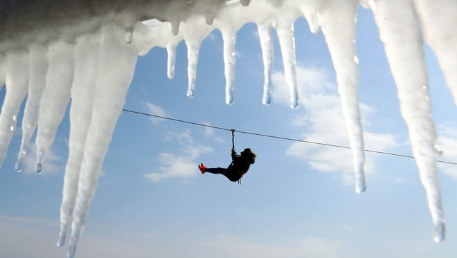 Icicles hang from a handrail as a rider travels across a zip line over an inlet of the Sea of Japan south of Anmok Beach at the PyeongChang 2018 Winter Olympic Games.