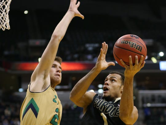 Irish forward Austin Burgett (Avon) tries to stop Boilermaker Bryson Scott from scoring in the Crossroads Classic at Bankers Life Fieldhouse, Dec. 20, 2014.