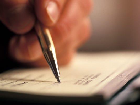 -Biz writing check.jpg_20140313.jpg