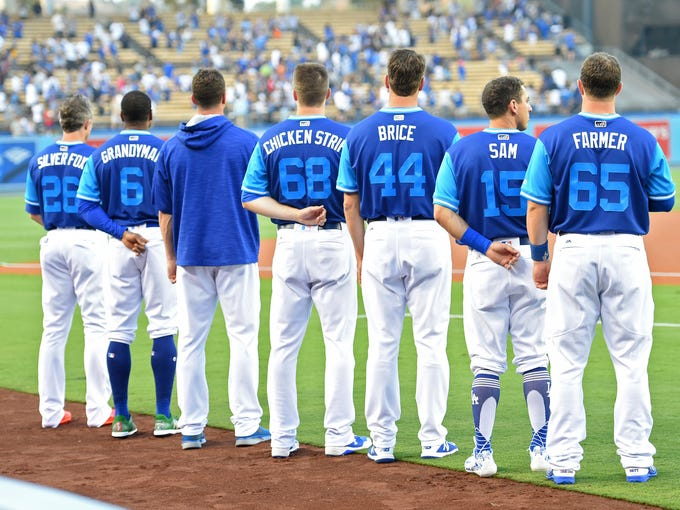 Members of the Dodgers stand for the National Anthem 000e126ff0f