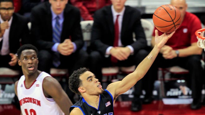 Duke's Tyus Jones (5) shoots past Wisconsin's Nigel Hayes during the first half Wednesday night at the Kohl Center.