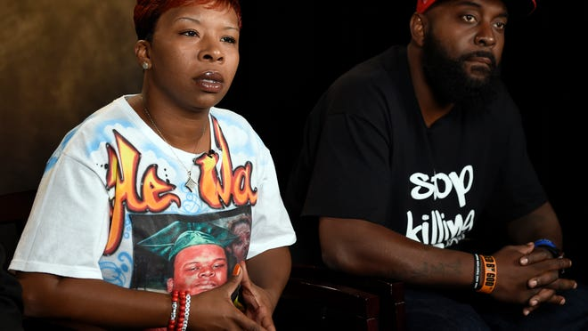The parents of Michael Brown, Lesley McSpadden, left, and Michael Brown, Sr., right, speak to The Associated Press during an interview in Washington, Saturday, Sept. 27, 2014.