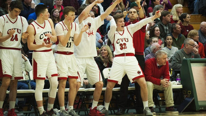 The CVU bench celebrates during the boys semifinal basketball game between the Missisquoi Thunderbirds and the Champlain Valley Union Red Hawks at Patrick Gym on Tuesday night March 7, 2017 in Burlington.