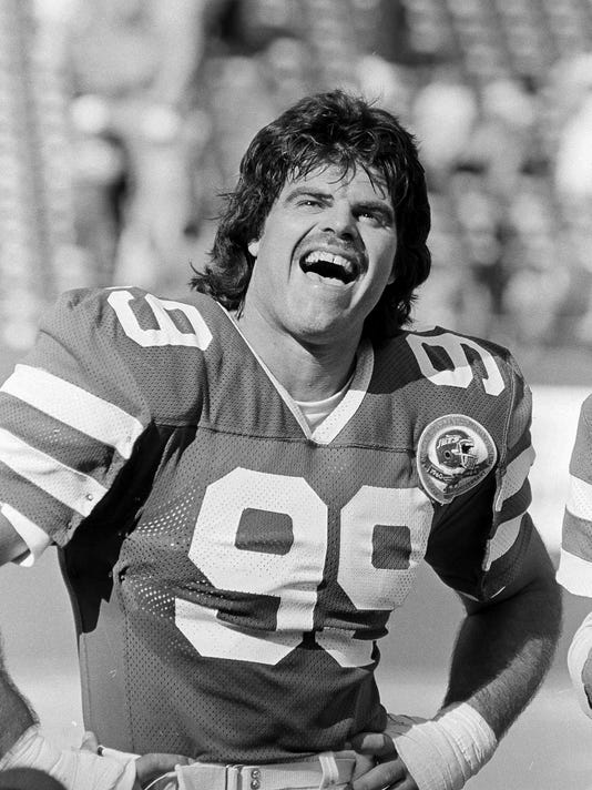 FILE - In this Sept. 16, 1984 file photo, New York Jets Mark Gastineau reacts at the end of an NFL football game against the Cincinnati Bengals in East Rutherford, N.J. Former New York Jets sack-dancing star Mark Gastineau says he is suffering from several health issues caused from years of playing football. The 60-year-old Gastineau says during a radio interview with Pete McCarthy on 710 WOR Radio in New York that he has been diagnosed with dementia, Alzheimer's disease and Parkinson's disease, Thursday, Jan. 19, 2017. (AP Photo/Bill Kostroun, File)