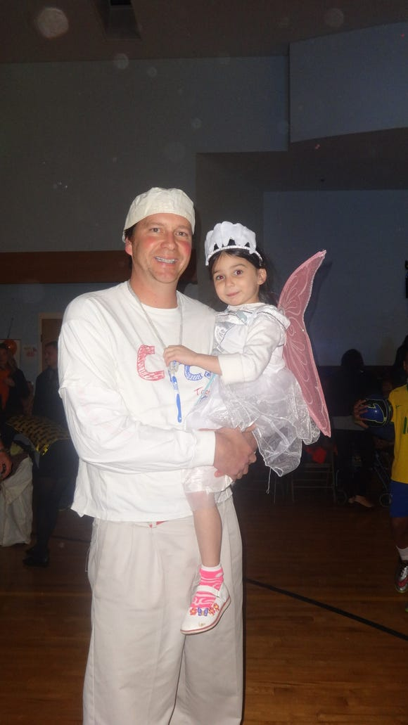Coach Allan Mutrie and his daughter, the Tooth Fairy (Provided photo)