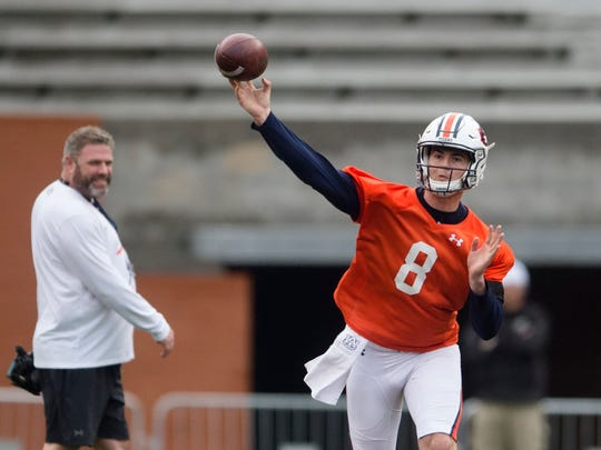 Auburn quarterback Jarrett Stidham (8) throws a pass