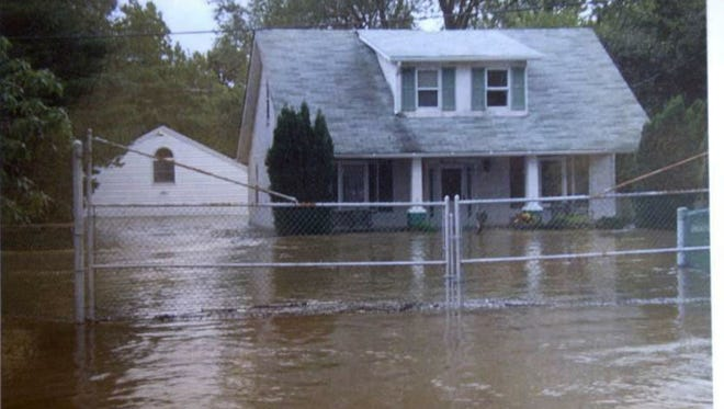 Floodwaters from a storm surround a Marshallton home in 2004, during one of the incidents that prompted a more-than  decade-long effort to rewrite state stormwater and erosion-control regulations. A Superior Court judge threw out the result on Wednesday, citing state agency failure to follow rules for adopting regulations