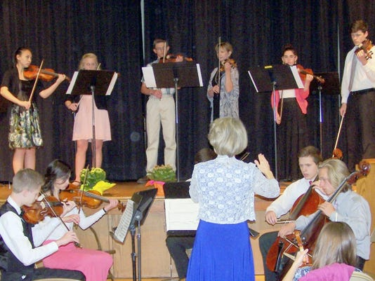 Venona Detrick, director of the YASS (York Area Suzuki Superbows), leads the graduating seniors (left to right on stage) Sarah Hill, Jenna Abrahamsen, Andrew Bowman, Joan Peffer (adult student), Hannah McCowan, and Samuel Ward during the 26th Annual YASS Spring Recital on April 25. The recital was hosted by The Church of Jesus Christ of Latter-day Saints in York Township.
