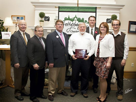 Gettysburg Adams Chamber names Small Business Person of the Year: Wilbur Slothour, owner and field administrator at Land and Sea Services in Aspers, is the Gettysburg Adams Chamber of Commerce 2015 Small Business Person of the Year. From left, are Rep. Will Tallman, Adams County Commissioner Jim Martin, Adams County Commissioner Randy Phiel, Wilbur Slothour, Adams County Commissioner Marty Qually, Gettysburg Adams Chamber of Commerce President Carrie Stuart and Senator Rich Alloway representative Scott Pitzer. Slothour was recognized during the chamber's annual Economic Breakfast recently at Biggerstaff's Catering in Gettysburg.