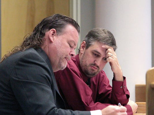 Joshua Prather, 35, right, talks with his defense attorney Todd Holmes during his trial in 12th Judicial District Court Friday. Prather is being tried on 62 counts of tampering with public records while he was employed as an appraiser with the Otero County Assessor's Office.