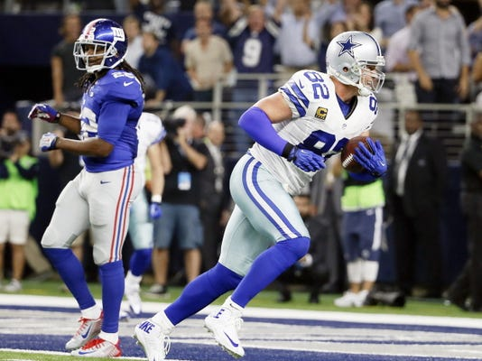 Dallas Cowboys tight end Jason Witten gets past New York Giants safety Brandon Meriweather for a touchdown late in the second half of their game Sunday in Arlington.