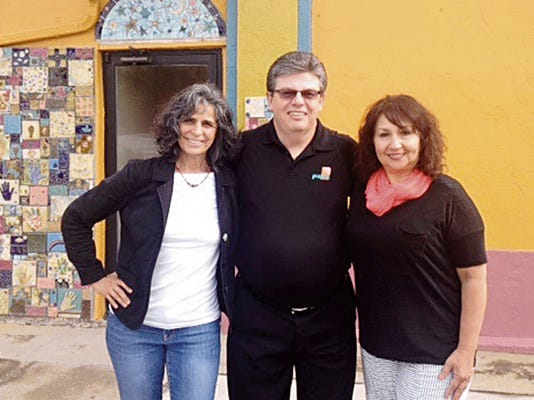 Standing at the future site of the PNM Power Up Grant revitalization/beautification project for Life Quest Inc. in Silver City are, from left, Life Quest COO Debra Frasca; PNM Community Manager For Southwest NM Bruce Ashburn; and Life Quest CEO Evangeline Zamora. Courtesy Photo