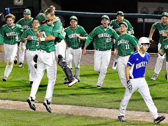 Donegal reacts as Spring Grove's Caleb Ruth, front right, walks back to his team after the final out in the eighth inning during the District 3-AAA championship game at Santander Stadium in York on Thursday. Spring Grove would fall to Donegal 11-5.