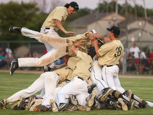 The Cathedral Fighting Irish form a dog pile on the