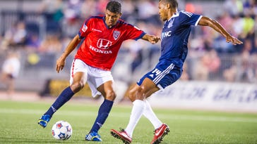 Indy Eleven's Sergio Pena works to control the ball against the defense of Carolina Railhawk's Jordan Graye, Sept. 27, 2014, at Michael A. Carroll Track & Soccer Stadium in Indianapolis.