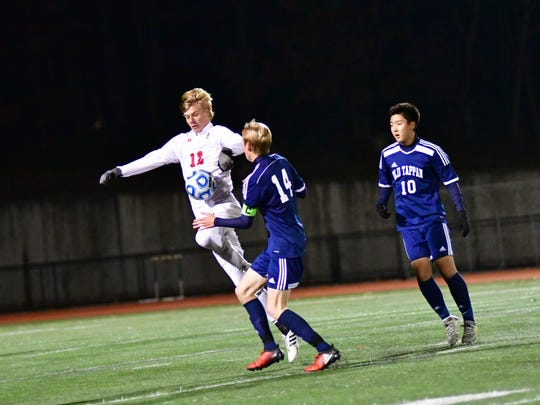 Hans Gallagher (No. 12) battles for a ball for Mendham