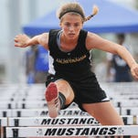Macie Monborne of Merritt Island wins the 100 hurdles at the Class 3A, District 13 Championships at Merritt Island High.