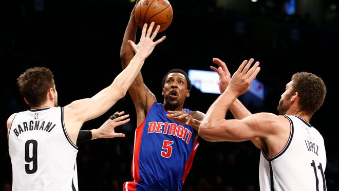 Nets center Andrea Bargnani (9) and Brook Lopez (11) defend Pistons guard Kentavious Caldwell-Pope (5) as Pope goes up for a layup in the first half of the Pistons' 87-83 loss Sunday in Brooklyn.
