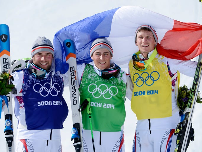 French skiers Arnaud Bovolenta (silver medal) and Jean Frederic Chapuis (gold medal) and Jonathan Midol (bronze medal) celebrate on the podium after the men's ski cross final.