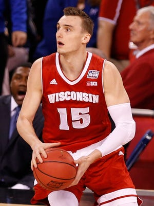 Apr 6, 2015: Wisconsin Badgers forward Sam Dekker (15) looks to shoot during the first half against the Duke Blue Devils in the 2015 NCAA Men's Division I Championship game at Lucas Oil Stadium.