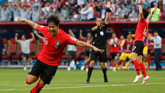 South Korea's Kim Young-gwon celebrates scoring his side's first goal during the group F match against Germany. South Korea's 2-0 win eliminated the defending World Cup champions.