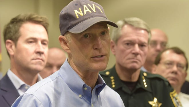 Gov. Rick Scott gives a weather update at the Escambia County EOC Thursday morning.