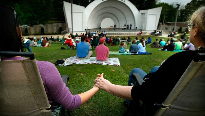 042511 WIRE   A1 LEAD              April 24, 2011 - Marissa Consolantis, left, and Carol Consolantis share a moment during a Community Easter Sunrise Service at the Levitt Shell Sunday at Overton Park. Four area churches gathered to renew the traditional Shell service that was cancelled over 5 years ago. (Jim Weber/The Commercial Appeal)