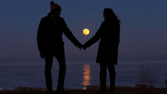 Badrinath Uppalapati (left) and his girlfriend, Bhargavi Tadinada, both of Milwaukee, pause for a moment after checking out the super moon off the shores of Lake Michigan near Bradford Beach in Milwaukee on Monday, Jan. 1, 2018. Full moons on Jan. 1 and 31 will be followed by full moons on March 1 and March 31. The last time two blue moons happened in the same year was 1999.