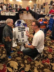 Steve Schmidt, right, talks with actor Felix Silla
