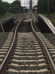 This rail bridge in Pennsauken was damaged when a garbage