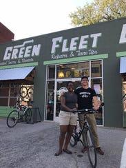 Austin Bauman with Jessica Ruff, a neighbor of Green Fleet Bicycle Shop who rides in a neighborhood bike ride.