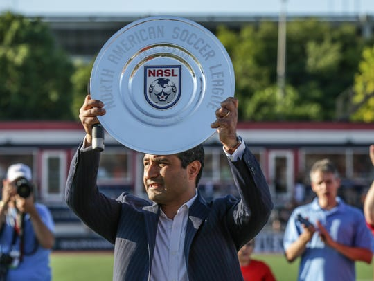 Indy Eleven owner Ersal Ozdemir holds up the 2016 spring