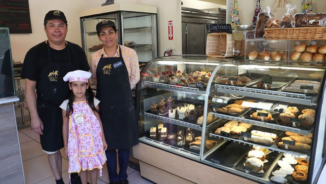 Alberto and Elizabeth Cervantes with their daughter Kamillah at Carousel Bakery in Palm Springs, July 3, 2018.