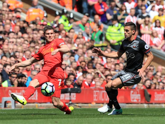 Liverpool's James Milner, left, and Southampton's Dusan Tadic battle for the ball during their English Premier League soccer match at Anfield, Liverpool, England, Sunday, May 7, 2017. (Peter Byrne/PA via AP)