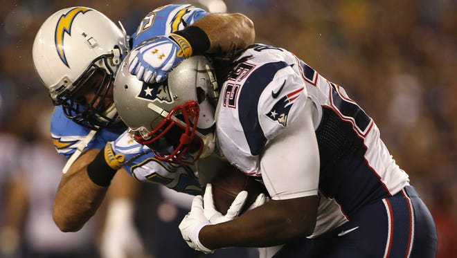 SAN DIEGO, CA - DECEMBER 07:  Running back LeGarrette Blount #29 of the New England Patriots is tackled by outside linebacker Jarret Johnson #96 of the San Diego Chargers at Qualcomm Stadium on December 7, 2014 in San Diego, California.  (Photo by Todd Warshaw/Getty Images)