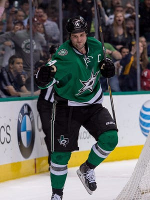 Dallas Stars left wing Jamie Benn (14) celebrates after scoring a goal against the St. Louis Blues during the second period at the American Airlines Center.