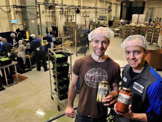 Bob and Joe McClure, owners of McClure's Pickles, have