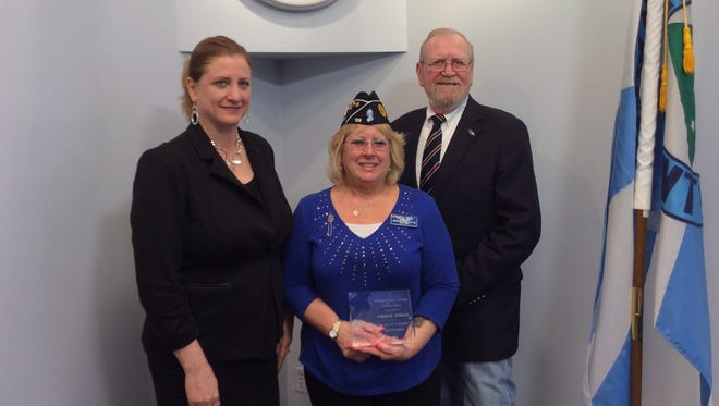 Rockland County Veterans Service Agency Deputy Director Susan Branam, left, and the agency's Director Jerry Donnellan, right, pose for a picture with the 2015 Freedom Award honoree Maureen Morgan, center.