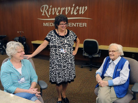 Kate Schneider, center, patient advocate/volunteer coordinator, Riverview Medical Center, shares a light moment with volunteers, Carla Lobner, left, and Germaine Thompson.