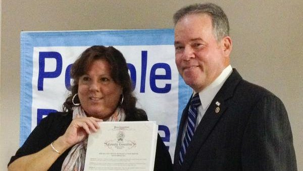 Rockland County Executive Ed Day issued a proclamation declaring September 2014 as Hunger Action Month during a ceremony  Sept. 3 at People to People's Nanuet office. Diane Serratore, the hunger relief organization's executive director accepted the honor.