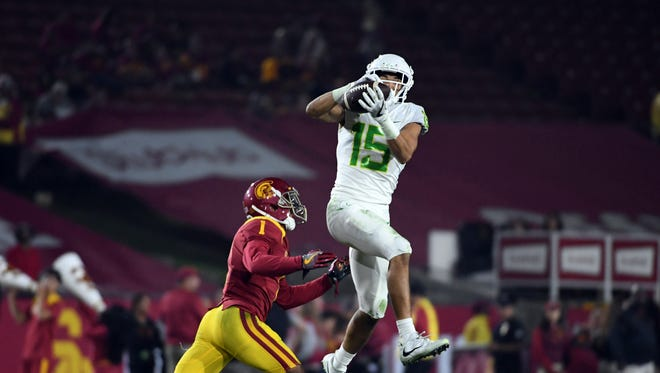 Nov 5, 2016; Los Angeles, CA, USA; Oregon Ducks wide receiver Jalen Brown (15) is defended by Southern California Trojans defensive back Jack Jones (1) on a 35-yard reception in the fourth quarter during a NCAA football game at Los Angeles Memorial Coliseum. USC defeated Oregon 45-20.