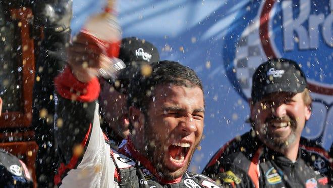 Darrell Wallace Jr. celebrates winning the NASCAR Camping World Truck Series race at  Martinsville Speedway.