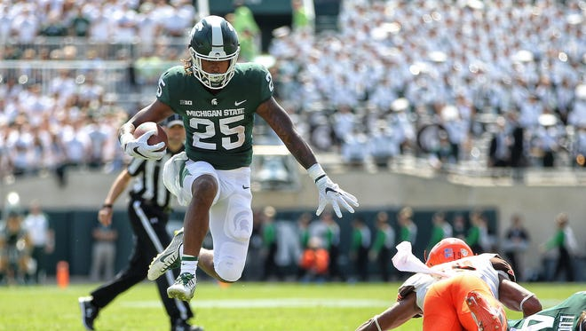 Michigan State Spartans wide receiver Darrell Stewart Jr. (25) runs with the ball during the first quarter Saturday at Spartan Stadium.