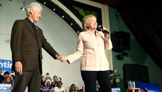 Democratic presidential candidate Hillary Clinton, accompanied by her husband former President Bill Clinton, speaks at a rally at The Col Ballroom in Davenport, Iowa, Wednesday, Jan. 27, 2016.