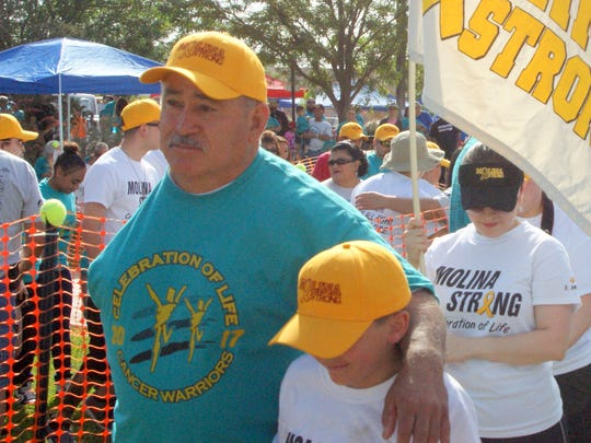 "Cancer Warrior Ricardo Molina leads the Molina Strong Team aroudn the rim of Voiers' ""Pit"" Park on Saturday."