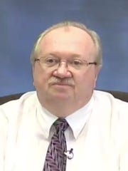 The Indiana BMV's chief financial officer, Harold Day, is shown in this still from a video of his testimony in a deposition in 2014.