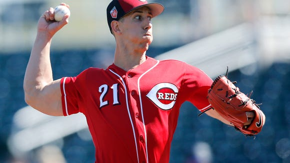 Cincinnati Reds pitcher Michael Lorenzen (21) delivers a pitch in the top of the first inning of the Spring Training game between the Cincinnati Reds and the Colorado Rockies at Goodyear Ballpark in Goodyear, AZ, on Saturday, Feb. 24, 2018.